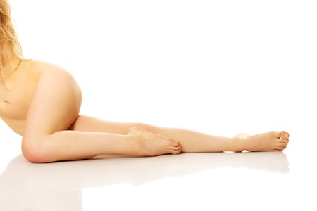 nude female: Close up on nude female legs with bended knee.