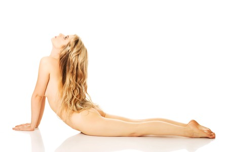 health woman: Young nude woman in bend yoga pose.