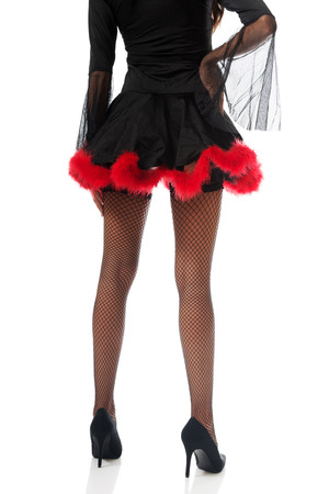 Back view of woman legs wearing devil clothes. photo
