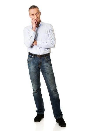 chin: Full length handsome man touching chin.