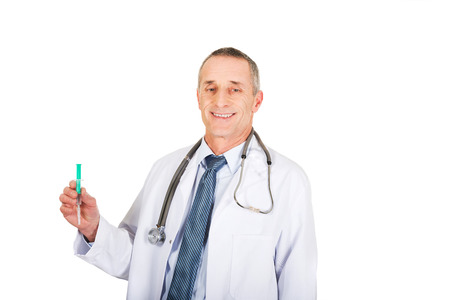 Portrait of male doctor holding a syringe. photo