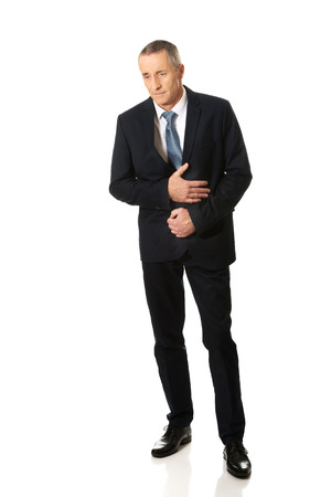 intestinal problems: Full length businessman suffering from stomachache.