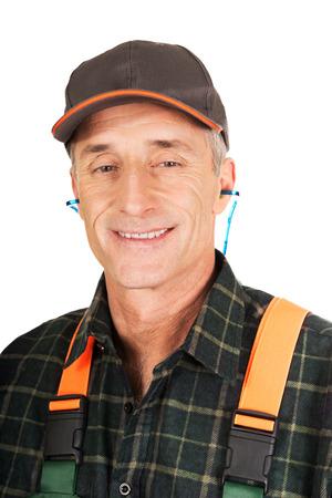protectors: Experienced gardener wearing ear protectors