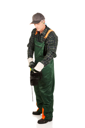 gasoline powered: Mature sawyer in workwear holding a chainsaw.