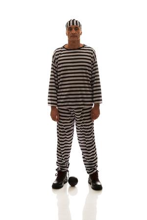 Mature sad man prisoner criminal with chain ball. photo