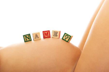 abdomen female: Mujer embarazada con el vientre femenino nombre cuesti�n Foto de archivo
