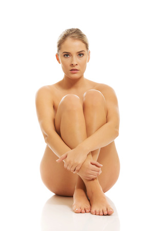 nude women: Nude woman sitting on the floor. Stock Photo