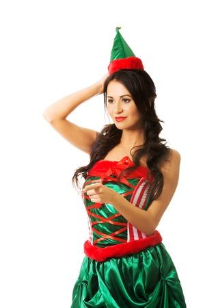 duendes de navidad: Retrato de mujer con ropa de elf apuntando hacia la izquierda. Foto de archivo