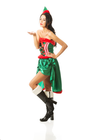 full length woman: Full length woman wearing elf clothes blowing a kiss.