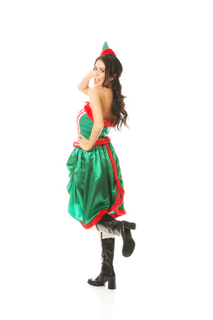 sexy xmas elf: Back view of woman wearing elf clothes bending knee.