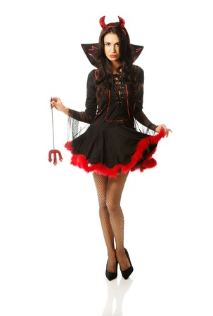 full length woman: Full length woman wearing devil clothes, holding trident. Stock Photo