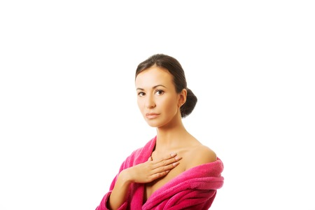 Portrait of a woman wearing pink bathrobe. photo