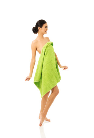 full length woman: Full length woman standing wrapped in towel. Stock Photo