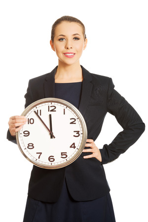 corporate waste: Businesswoman with clock Stock Photo