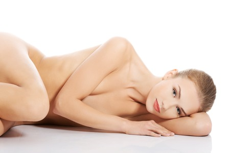 breasts: Sexy fit naked woman lying down on the floor Stock Photo