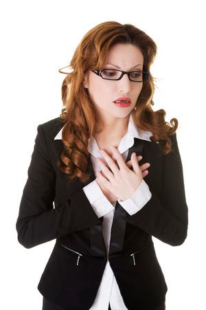 palpitations: Sick businesswoman having heart disease.