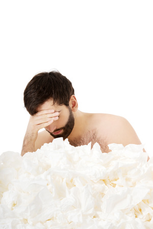 Sick man with a lot of tissues. photo