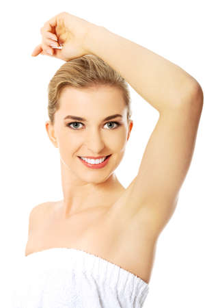 Beautiful happy spa woman showing her shaved armpit. Stock Photo