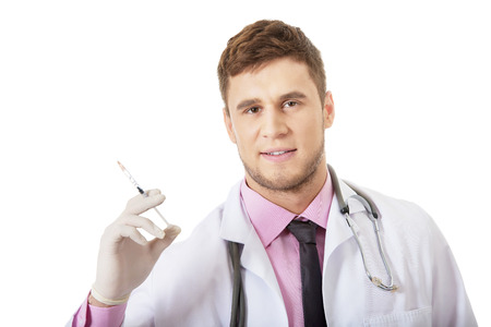 Handsome male dentist doctor holding a syringe. photo