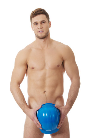 naked male body: Young handsome nude man covering his self with helmet.