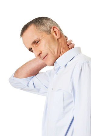 senior man on a neck pain: Mature man suffering from neck pain.