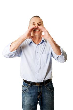 someone: Handsome mature man calling someone