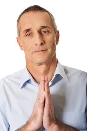 repentance: Handsome mature man praying to God. Stock Photo
