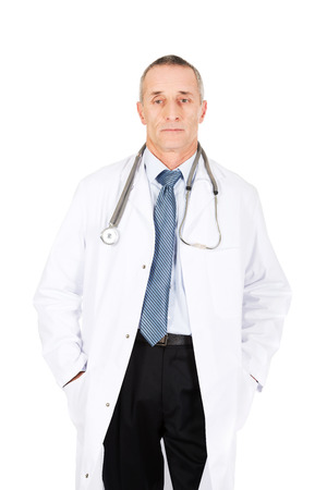 Confident male doctor with hands in pockets. photo