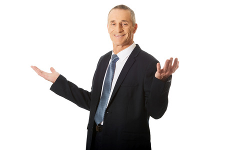 undecided: Mature businessman in undecided gesture. Stock Photo