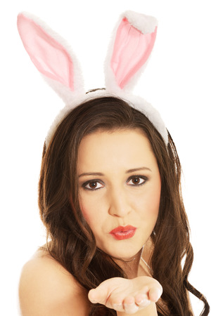 playboy: Woman wearing bunny ears and blowing a kiss. Stock Photo