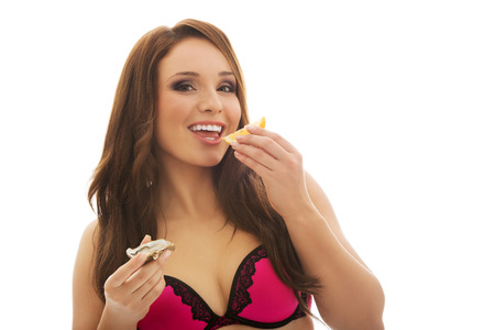 eroticism: Beautiful woman eating raw oyster with organic lemon. Stock Photo