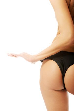 Female sexy slim buttocks in black panties. photo