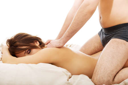 male underwear: Relaxing young couple making massage at home. Stock Photo