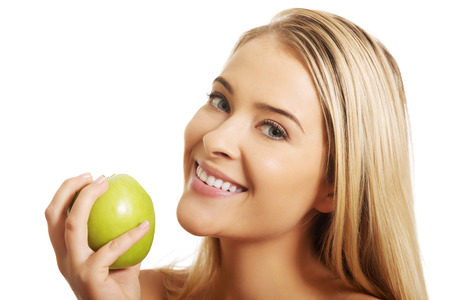 smile face: Smiling beauty holding green apple
