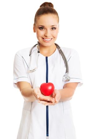 Female doctor holding heart model. photo