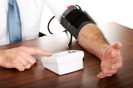Closeup on businessman measuring blood pressure. photo