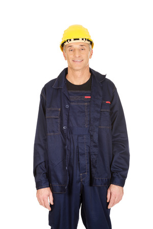 studio happy overall: Smiling mature worker with hard hat. Stock Photo