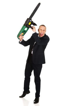 cocky: Furious mature businessman with chainsaw.
