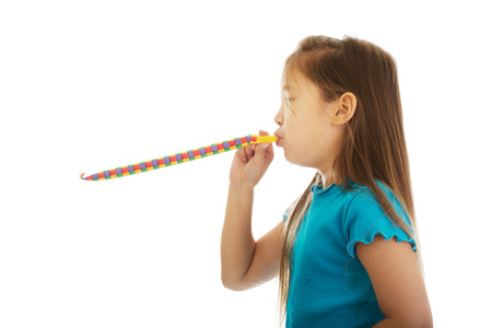 fringes: Cute little girl blowing ribbon Stock Photo