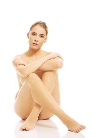 naked woman sitting: Nude woman sitting on the floor. Stock Photo