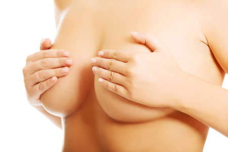 anatomy naked woman: Shirtless healthy woman examining her breast. Stock Photo