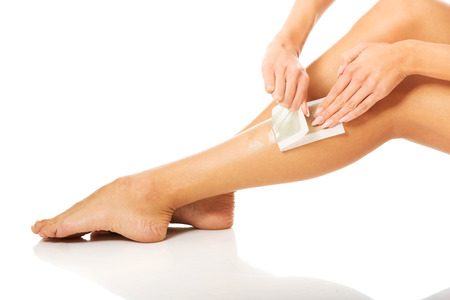 waxed: Close up of woman legs waxed.