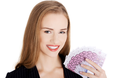woman holding money: Young beautiful business woman holding money- euro currency. Isolated on white.