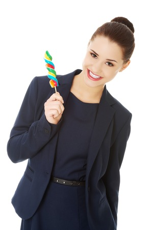 lolipop: Young happy businesswoman holding spiral lolipop Stock Photo