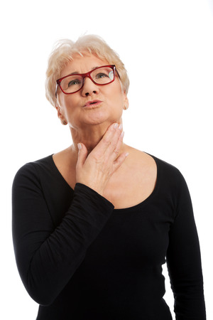Senior woman suffering from throat pain Stock Photo