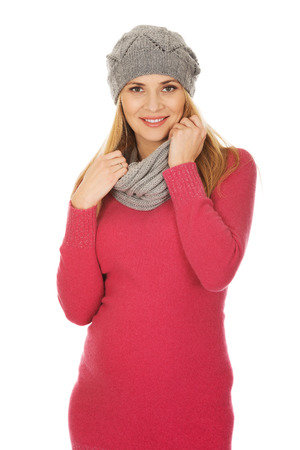 outerwear: Pregnant woman in outerwear touching her belly