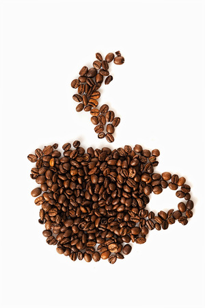 Coffee beans in shape of cup photo