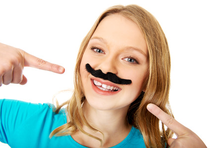 fake smile: Happy teenage woman with a moustache Stock Photo
