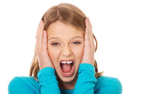angry sad: Young angry teenager screaming loud