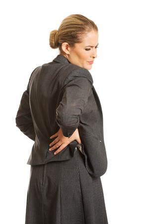 Businesswoman having huge back pain photo